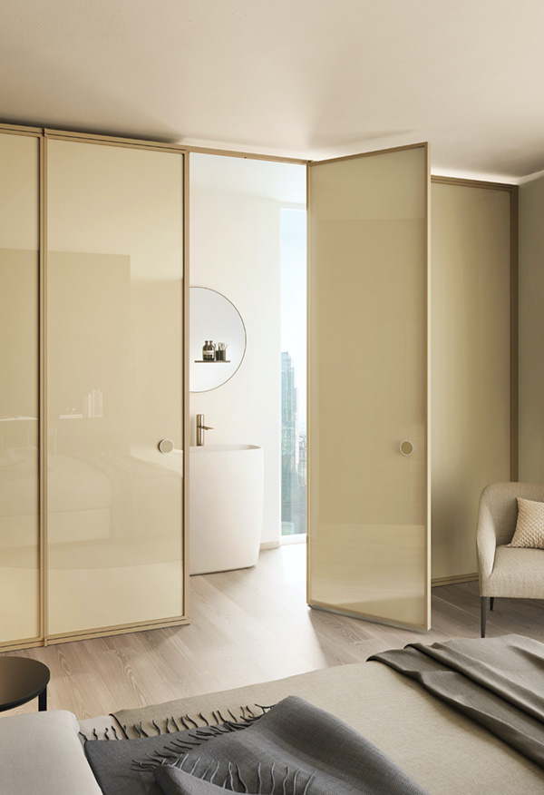 The Suite partition wall is made from laminated, monolithic glass and stylishly divides your bathroom from the bedroom